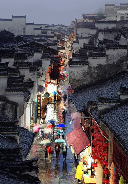 Huizhou - Tunxi Old Street (China); the way the color and greys play in this photo remind me of Miayazaki's Spirited Away.