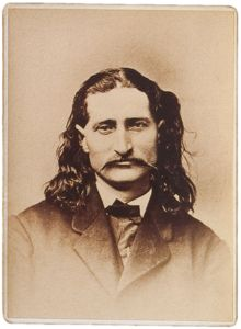 On this day in 1876, Hickok was playing cards with his back to the saloon door. At 4:15 in the afternoon, a young gunslinger named Jack McCall walked into the saloon, approached Hickok from behind, and shot him in the back of the head. Hickok died immediately. McCall tried to shoot others in the crowd, but amazingly, all of the remaining cartridges in his pistol were duds. McCall was later tried, convicted, and hanged.