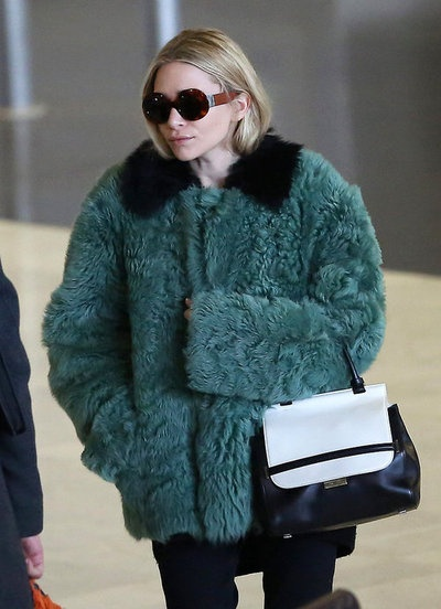 #AshleyOlsen wore a green Marni Edition Lambs Fur Jacket at Charles de Gaulle Airport in Paris February 27, 2013