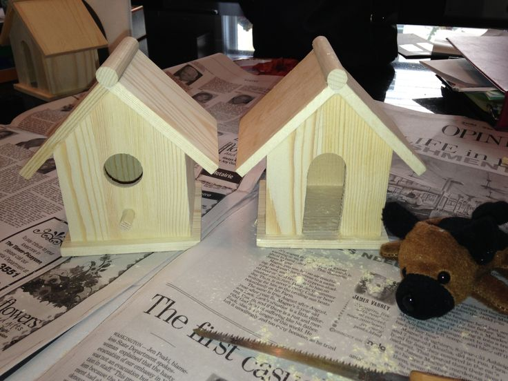 From birdhouse to doghouse!   Craft for a Puppy Birthday Party  Easy to do and cheap! Puppy in the photo came from Oriental Trading. Birdhouses came from Hobby Lobby. The children painted the dog houses and adopted a dog with a certificate.