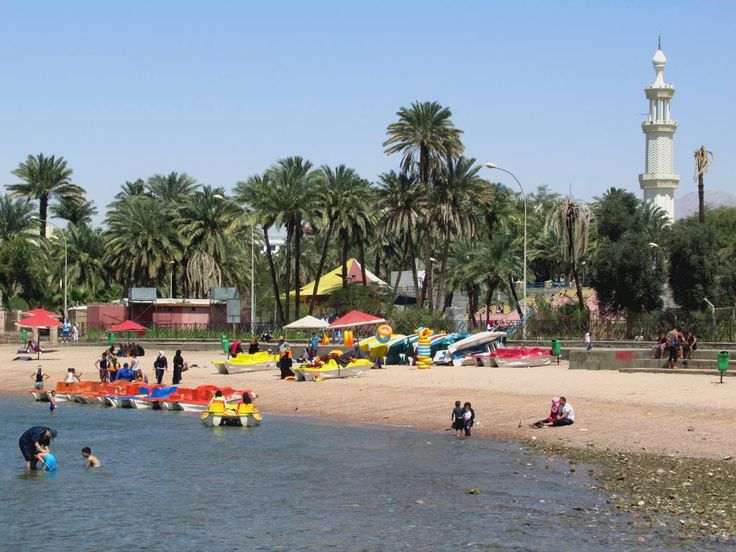 The public beach at Aqaba, Jordan, is popular among locals who hire peddle boats. Glass bottom boats are also available.