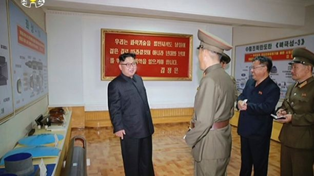 "In this image made from video of a news bulletin aired by North Korea's KRT on Wednesday, Aug. 23, 2017, leader Kim Jong Un visits the Chemical Material Institute of Academy of Defense Science at an undisclosed location in North Korea. North Korea's state media released photos that appear to show concept diagrams of the missiles hanging on a wall behind leader Kim Jong Un, one showing a diagram for a missile called ""Pukguksong-3."" Independent journalists were not given access to cover the…"