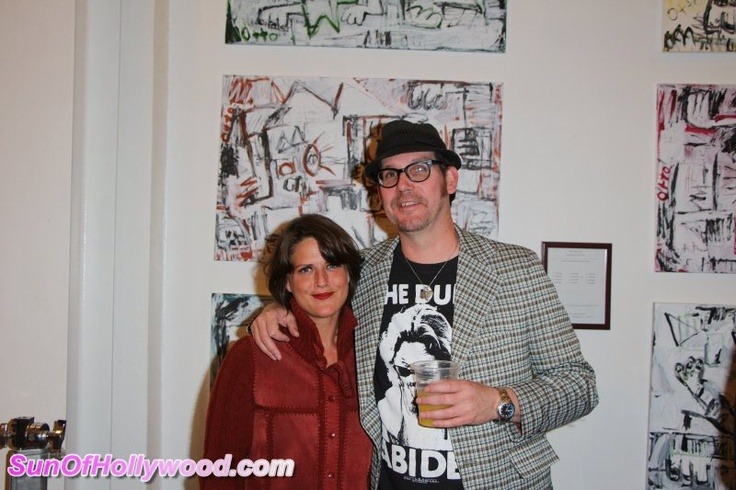 Annie Preece and Johnny Otto pose in front of one of Ottos paintings at the Ashley Paige Bikini Factory. Photo courtesy of SunofHollywood.com WHAT TARA REID CAN TEACH YOU ABOUT HAPPINESS – AT THE ASHLEY PAIGE BIKINI FACTORY www.miraclemilegirls.wordpress.com