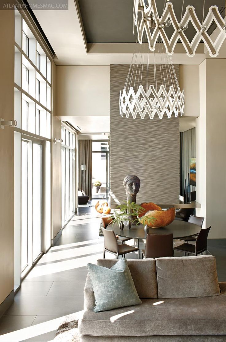 Atlanta Penthouse of Matthew Quinn and Ric Parrish   styled by Clinton Smith   photo by Mali Azima   as seen in Atlanta Homes and Lifestyles   Xoom chandeliers found in Germany which contract to 15½ inches and expand to nine feet