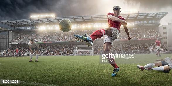 Stock Photo : Soccer Player Kicking Ball