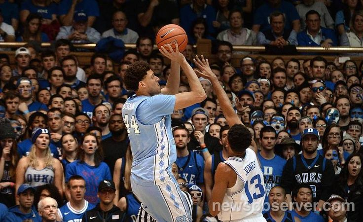 UNC forward Justin Jackson (44) scores over Duke guard Matt Jones (13) in the first half at Cameron Indoor Stadium in Durham, N.C. Thursday, Feb. 9, 2017.