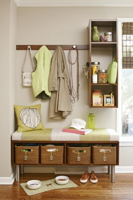 Easy organization: Tie a DIY mudroom area together with matching shelving, hooks and bench seating.  Clear containers and basket storage keep items in their place.