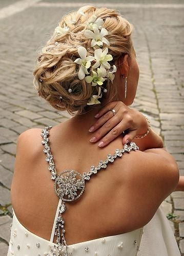 Wavy buns designet for wedding decorated with beads and white flowers