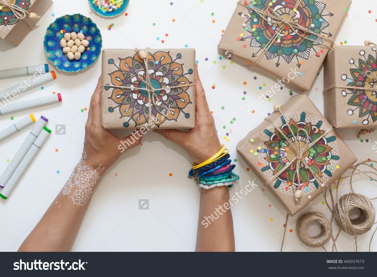 Gifts Wrapped In Kraft Paper. On Boxes Painted Mandala Pattern. Стоковые фотографии 449937673 : Shutterstock