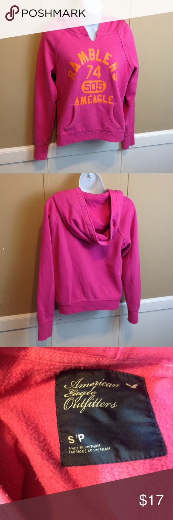 "American Eagle Hoodie Maker: American Eagle Outfitters ♥ Material: 80% Cotton 20% Polyester ♥ Color: Pink ♥ Measured Size: Pit to pit- 19"" Pit to cuff- 19"" Shoulder to waist- 21""  ♥ Tag Size:  S ♥ Actual Size: S PLEASE CHECK YOUR ACTUAL MEASUREMENTS TO MAKE SURE IT IS THE RIGHT SIZE! THANKS! ♥ Condition: Great Used Condition  ♥ Item #: (office use only) F  Follow us on Instagram and facebook for coupon codes!  INSTAGRAM-thehausofvintage1984 Facebook- intergalactic haus of vintage 1984 or…"