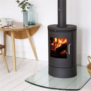 Contemporary Stoves - Morso 6140 Convector - Well-designed classic wood burning stove with beautiful curves Morsø 6140 is a minimalist wood burning stove in timeless design, with a large glass door that provides a splendid view of the dancing flames.