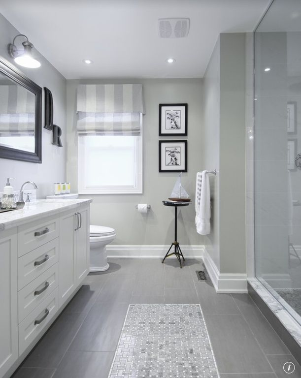 Traditional 3/4 Bathroom with VINTAGE FRENCH FARMHOUSE SCONCE, Flat panel cabinets, Paint, Casement, stone tile floors, Flush