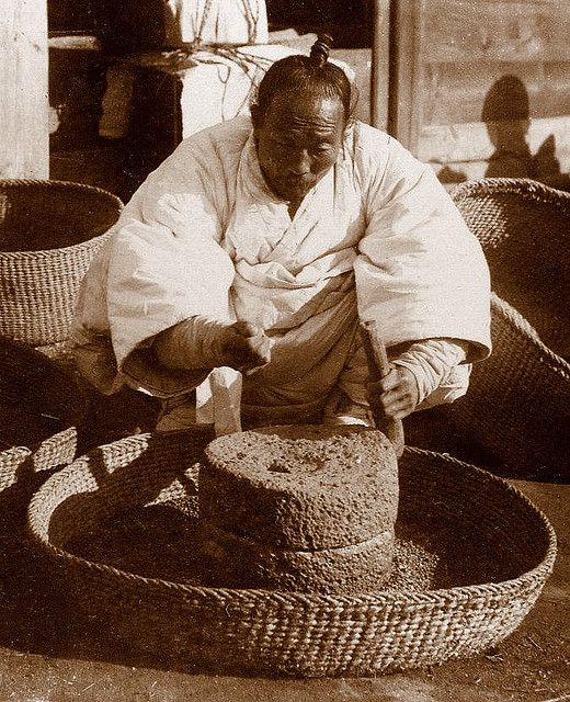 OLD KOREA - LAND OF THE MORNING CALM -- The Bean Grinder, SEOUL  ca. 1899-1900