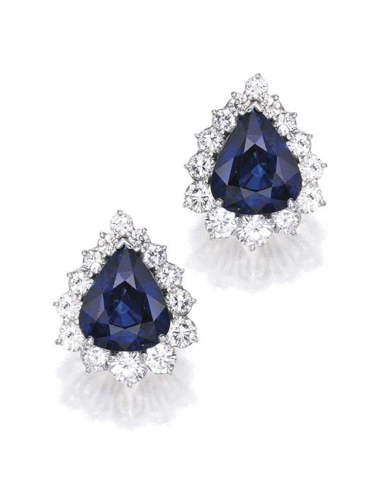 Pair of Platinum, Sapphire and Diamond Earclips Set with two pear-shaped sapphires weighing approximately 8.75 and 8.20 carats, framed by 32 round diamonds weighing approximately 4.85 carats.