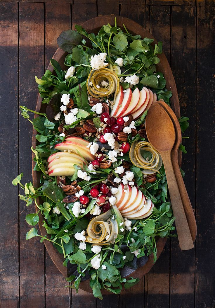 Harvest Salad - kale and watercress, topped with beautiful, crunchy SweeTango® Apples, pear roses, fresh cranberries, toasted pecans, sunflower seeds and goat cheese. All dressed in a fresh apple vinaigrette. Fall Harvest Salad - Seasons and Suppers