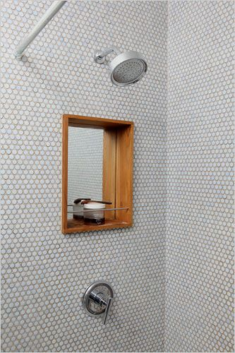 Walls and floor with penny tiles and a shaving mirror in the shower! Genius
