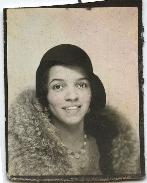 Photobooth portrait of young woman, 1930s.: