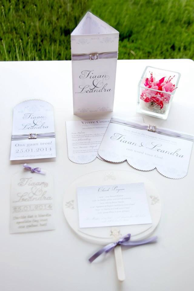 Wedding save the date, invitation, menu, fan church program and t-light holder with logo.