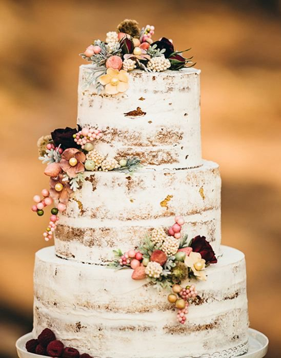 22. This barely naked cake has our names written all over it because we love a darling naked cake but can't dream of skimping out on all the frosting. There is more to love here in this Southern Wedding captured by Crystal Stokes and cake by Sky's The Limit.