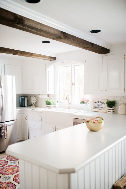 {The Details} Countertops || White Carrara Laminate Countertop thanks to Wilsonart 'Cassidy' Faucet with Touch 2O Technology || thanks to Delta Faucet Angelique Tiles Rug || thanks ...
