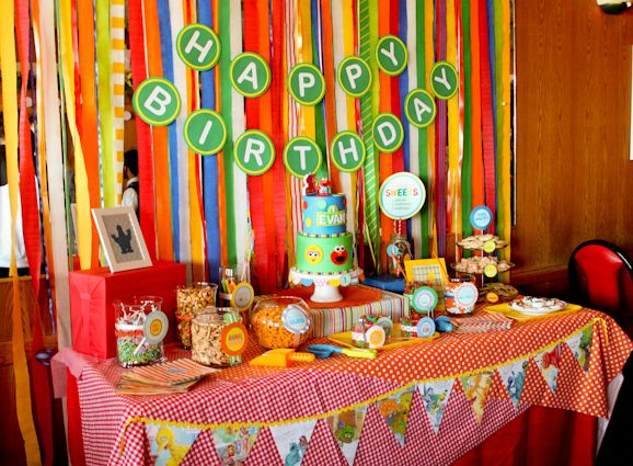 "Our clients wanted a colorful Sesame Street themed celebration to ring in their son's first birthday.  We were excited to create our very own rendition of an ""Elmo and friends"" party.  Not wanting to saturate the decor with typical Sesame Street characters, we focused on using bold, primary colors and tons of patterns to keep it fun.: 1St Birthday Parties, Colors Ness, Birthday Parties Ideas, First Birthday, Colors Streamers, Colors Picnics, 1St Birthdays, Birthday Party Ideas, Birthday Ideas"