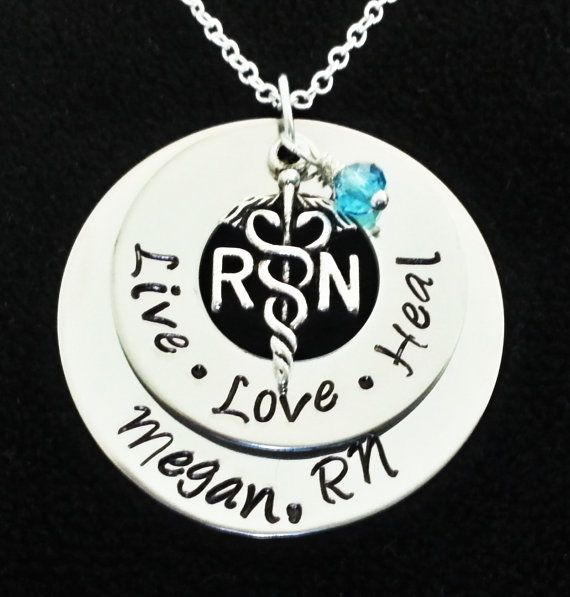 ~~~~~~This beautiful necklace is hand stamped on 1 1/2inch & 1 inch stainless steel washer added a RN charm and crystal too your choice you can