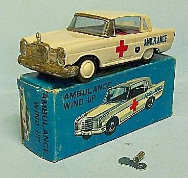 VINTAGE WIND UP TIN MERCEDES AMBULANCE, MIB. OLD STORE STOCK. VINTAGE TIN WINDUP MERCEDES AMBULANCE CAR MINT IN BOX. OLD STORE STOCK NEVER PLAYED WITH. CAR IS APROX. 6 inches LONG. TESTED WIND UP AND WORKS FINE. MADE IN KOREA. LOOKS AND DISPLAYS GREAT. Please see photographs, pictures, or computer scan images, if applicable, for more specific details. 2015pdp0073. SHELF 24, 29, 35, MR.