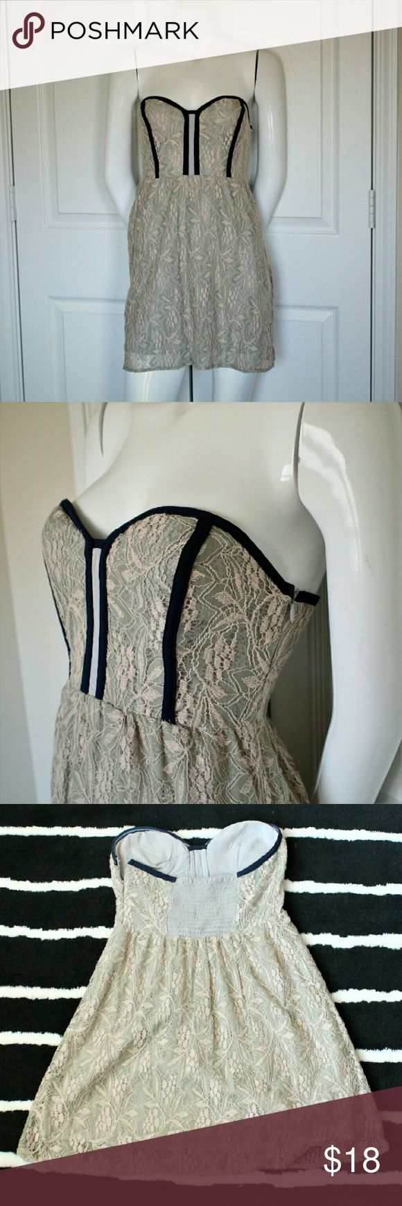 """Black Friday Sale! Pins&Needles Strapless Dress Flirty strapless Urban Outfitters dress in like new condition. The dress features built in bra cups, side zip and stretch back. The lining is a dove gray and has a cream and sea foam green lace overlay with navy piping. Measures 12"""" across at the waist, and 25"""" in length.   Please let me know if you have questions or need more pictures! Urban Outfitters Dresses Strapless"""