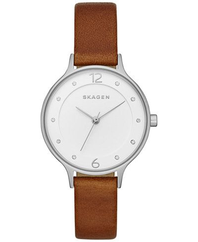 Simply styled, with a slender brown leather strap, this timepiece from Skagen's Anita collection look great with almost anything. | Brown leather strap | Round stainless steel case, 30mm | Silver-tone