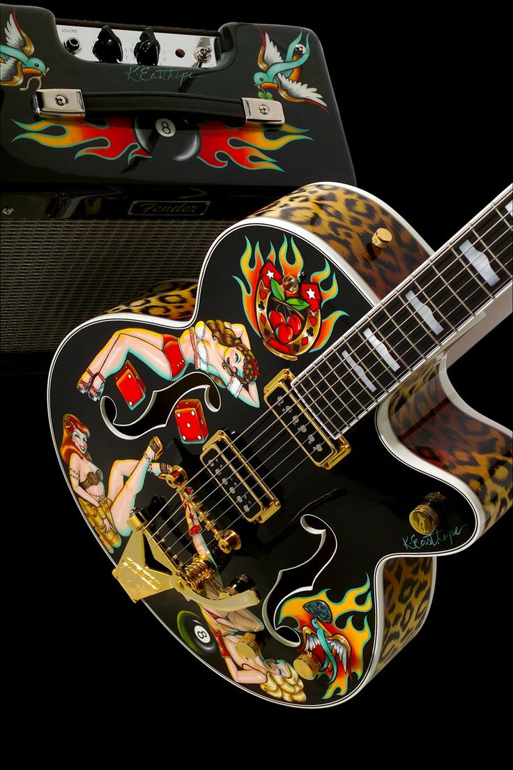 "GRETSCH Kristen Easthope Pinup | Hand-painted pinup girls from the talented palette of noted ""Queenpin"" artist Kirsten Easthope cavort all over this sultry black Gretsch 6120. Other features include a hand-painted purring-and-alluring leopard-skin motif on the sides and all the way up the neck and even on the back of the headstock, and a matching Fender Pro Junior amp."