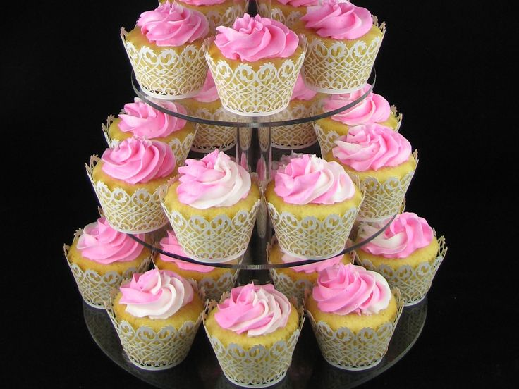 White chocolate mud cupcakes with pink and white variagated buttercream swirls and lace cases.