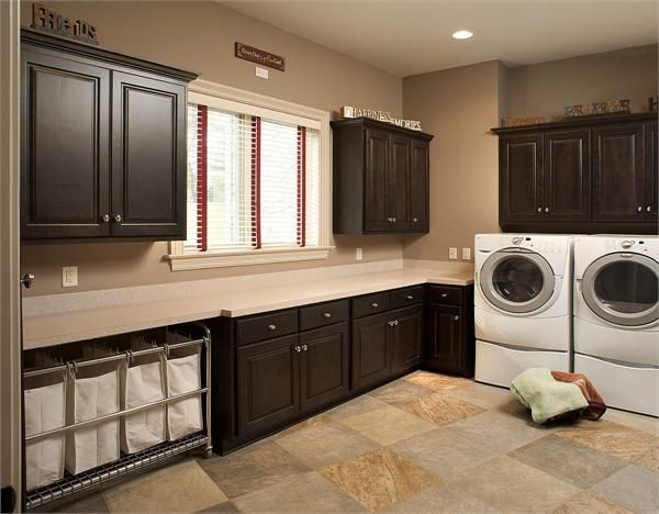 Large Laundry Room from Mullet Cabinet. I love everything about this laundry room, but instead of the hampers. I would like to put bens, but everything else is amazing.