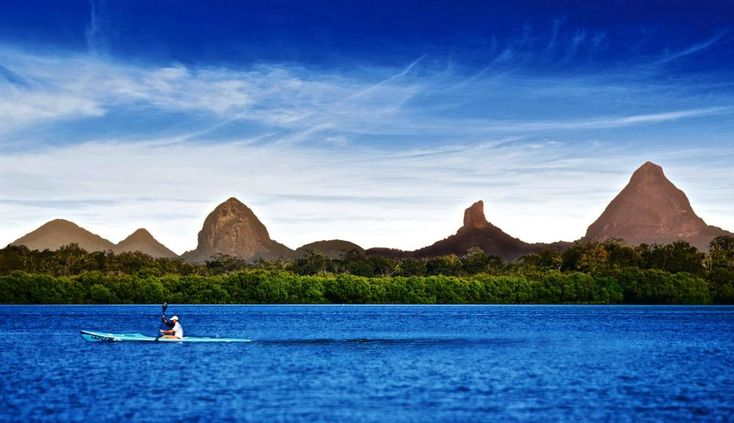 Landscape: Australia's Gorgeous Glasshouse Mountains along Sunshine Coast.  The most recognizable formation-Mount Tibrogargan-resembles a tree-filled gorilla staring out to sea.