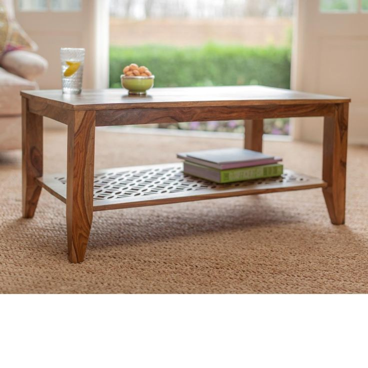 Coffee table made from hand waxed sheesham wood, with beautiful carved shelf. With an elegant carved design from our Jasmeen furniture collection in rosewood. Fair Trade. Hand made in India.