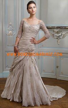 Ian Stuart-Bride belle robe de mariée originale glamour avec manche dentelle Style Brasilia
