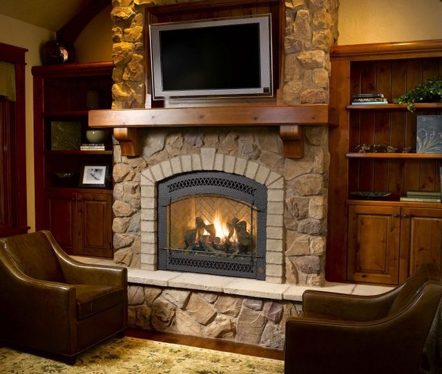 not these stones but match hearth and border of fireplace and then rest of wall in different stone/tile