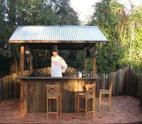 Bar Patio Ideas Outdoor Tiki Bar With Homemade Bar Stools More Best 25  Backyard Bar Ideas