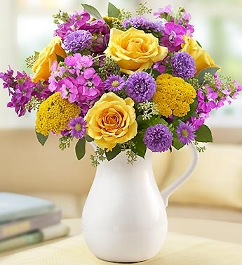 Make Her Day Bouquet- roses, stock, monte casino, bupleurum and salal in a striking, food-safe white handled ceramic pitcher $49.99- $69.99