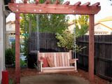 """DIY Yard swing with Trellis...I love this for the """"play"""" side of the yard to have a nice place to sit and watch kids play.  Though, I'd do something a little more fancy for the seat."""