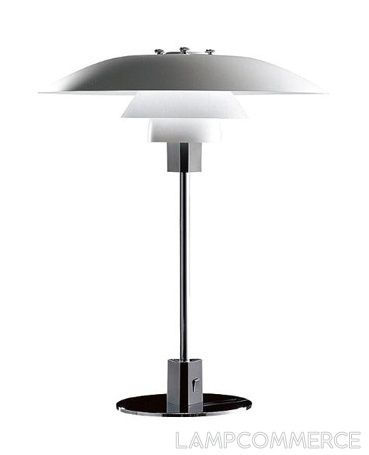 The PH 2/1 Table lamp is an example of classic nordic design lighting, by Louis Poulsen. It is perfect for a modern styled house, specially good in living rooms. Due to it's multi-screen reflecting system, this metallic finish lamp creates harmonious lighting without reflections. The project is based on a logarithm spiral. The structure is made of polished chrome. The lamp-shade is made of opaline glass.