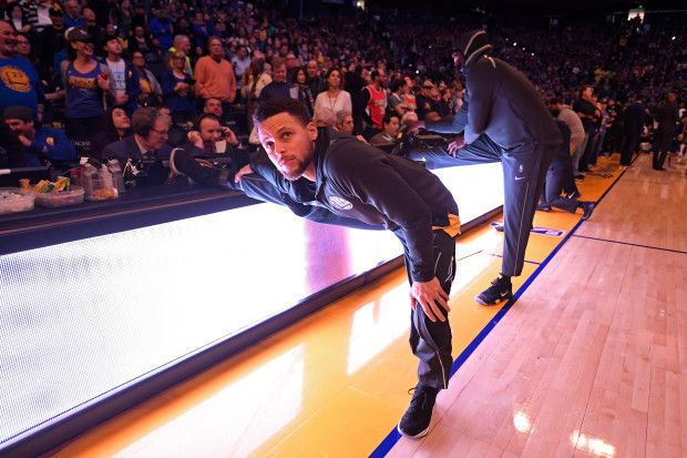 Golden State Warriors' Stephen Curry (30) stretches before the start of their NBA game against the Memphis Grizzlies at the Oracle Arena in Oakland, Calif., on Saturday, Dec. 30, 2017. (Jose Carlos Fajardo/Bay Area News Group)