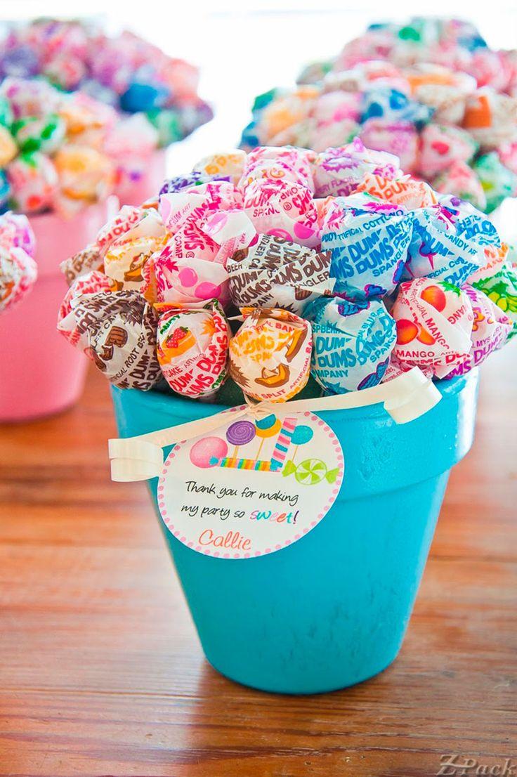 Dum-dum lollipop bouquets nestled in little painted potsperfect party  favors!