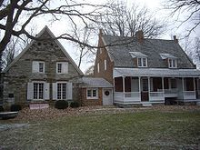 "AMERICAN COLONIAL HOUSE: In Maryland, Virginia, and the Carolinas, a style called ""Southern Colonial"" is recognized, characterized by the hall and parlor and central-passage house types, which often had large chimneys projecting from the gable-ends of the house."