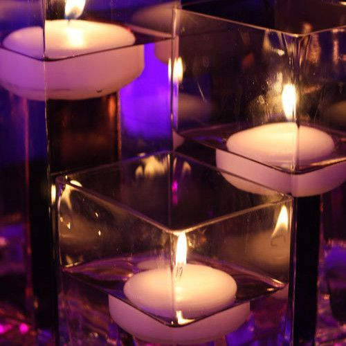The glowing light of the  floating candle, shown as a centerpiece. (other items sold separately)