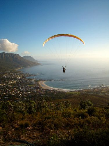 Paragliding over Cape Town offers splendid views of the city, seaside, and mountains.