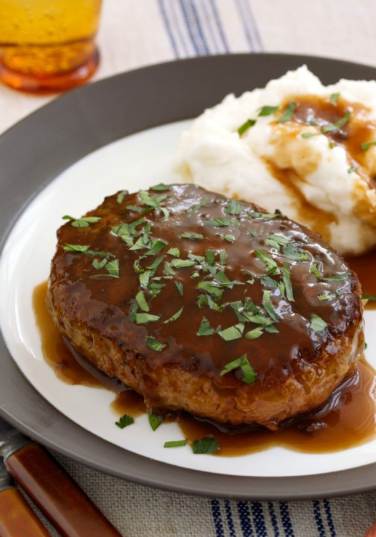 Salisbury Steak with Mashed Potatoes & Gravy – Got a hankering for a good meat and potatoes dish? Here's a great Salisbury Steak recipe—gravy included!