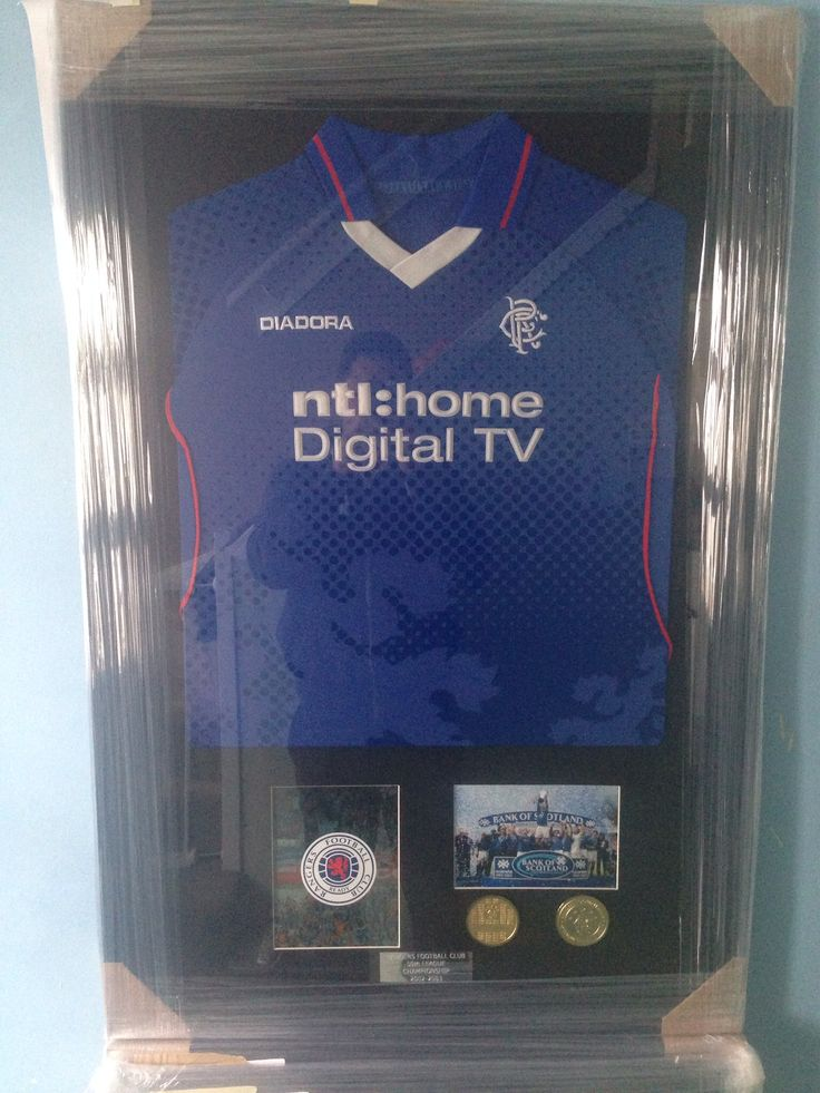 Football shirt framed with medals, cd cover and programme