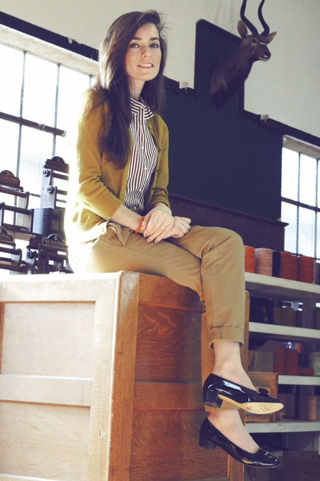 Work outfit: black and white striped button-up shirt, mustard cardigan, khaki trousers, low black heels -- professional
