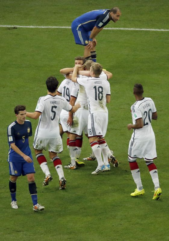Germany players celebrate after Mario Goetze scored during the World Cup final soccer match between Germany and Argentina at the Maracana Stadium in Rio de Janeiro, Brazil, Sunday, July 13, 2014.