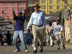 Robin walking down the street in Alexandra Township outside Johannesburg.